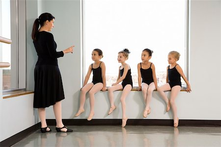 preteen models asian - Ballet instructor addressing students sitting in window Stock Photo - Premium Royalty-Free, Code: 604-01119433