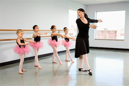 preteen models asian - Ballet instructor demonstrating position for students Stock Photo - Premium Royalty-Free, Code: 604-01119446