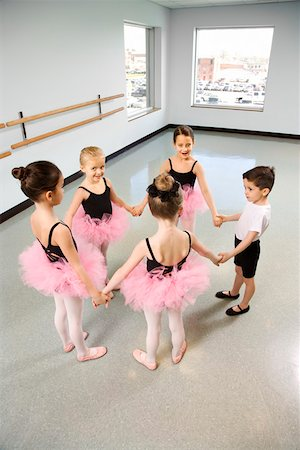 Ballet students standing in a circle and holding hands Stock Photo - Premium Royalty-Free, Code: 604-01119447