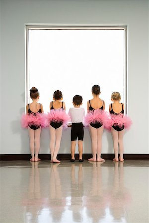 Rear view of ballet students standing by window Stock Photo - Premium Royalty-Free, Code: 604-01119450