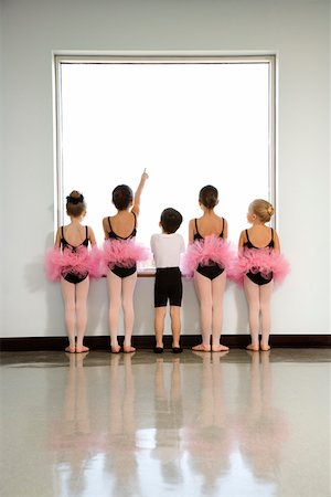 Rear view of ballet students standing by window Stock Photo - Premium Royalty-Free, Code: 604-01119451