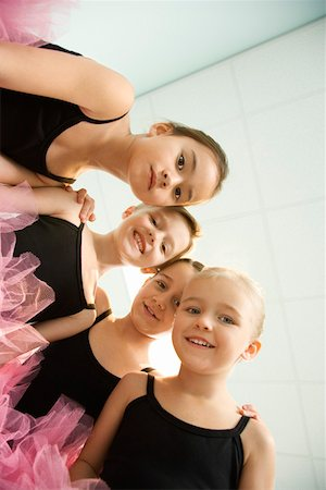 preteen models asian - Low angle portrait of girls in ballet class Stock Photo - Premium Royalty-Free, Code: 604-01119460