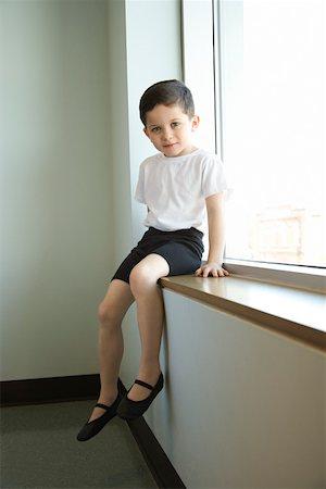 Boy in ballet class sitting in window Stock Photo - Premium Royalty-Free, Code: 604-01119487