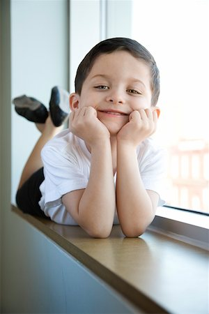 Boy in ballet class lying in window sill Stock Photo - Premium Royalty-Free, Code: 604-01119489