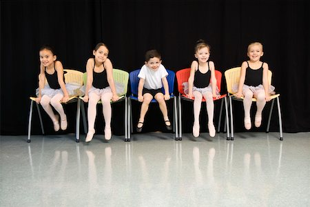 Ballet students sitting in a row Stock Photo - Premium Royalty-Free, Code: 604-01119493
