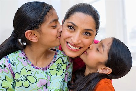 preteen kissing - Portrait of daughters kissing mother on cheeks Stock Photo - Premium Royalty-Free, Code: 604-01123428