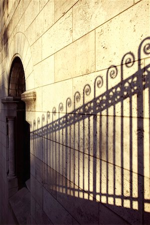 scroll (design) - Shadow of wrought iron fence Stock Photo - Premium Royalty-Free, Code: 604-01231763