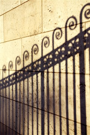 scroll (design) - Shadow of wrought iron fence Stock Photo - Premium Royalty-Free, Code: 604-01233141