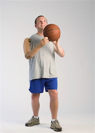 Amputee playing basketball Stock Photo - Premium Royalty-Free, Code: 604-01378150