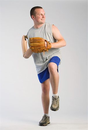 Amputee playing baseball Stock Photo - Premium Royalty-Free, Code: 604-01378151