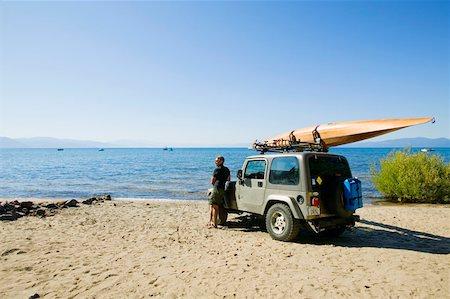 Kayaker on beach Stock Photo - Premium Royalty-Free, Code: 604-01378246