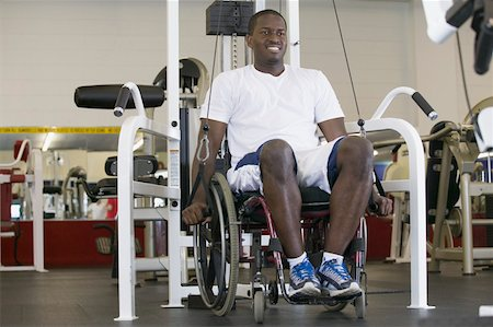 Man in wheelchair at gym Stock Photo - Premium Royalty-Free, Code: 604-01569858