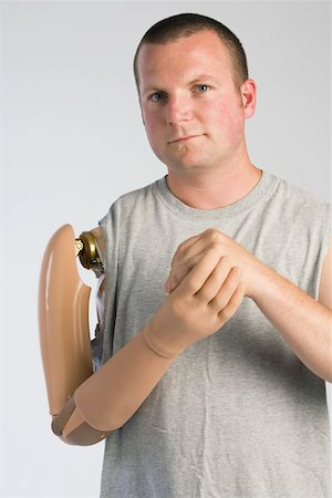 Man with prosthetic arm Stock Photo - Premium Royalty-Free, Code: 604-01569884