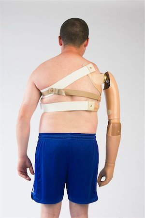 Rear view of man with prosthetic arm Stock Photo - Premium Royalty-Free, Code: 604-01569881