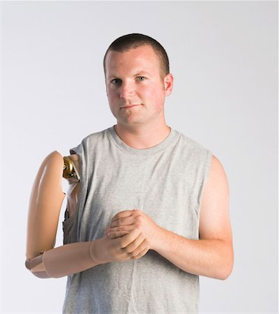 Man with prosthetic arm Stock Photo - Premium Royalty-Free, Code: 604-01569883