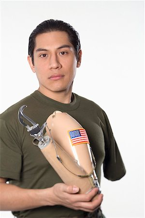 Man holding prosthetic arm Stock Photo - Premium Royalty-Free, Code: 604-01605857