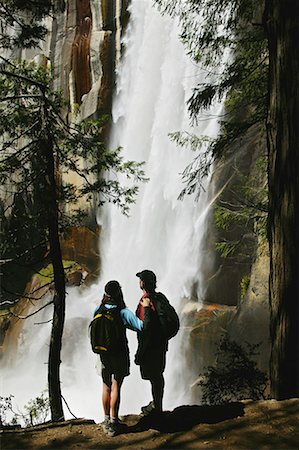 Couple standing beside waterfall Stock Photo - Premium Royalty-Free, Code: 604-01628792
