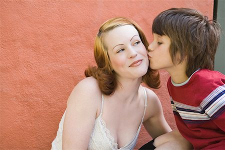preteen kissing - Son kissing mother Stock Photo - Premium Royalty-Free, Code: 604-01742162