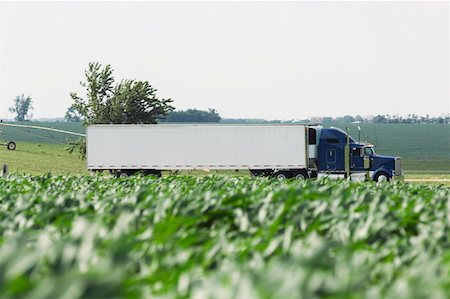 side view tractor trailer truck - 18 wheeler on rural road Stock Photo - Premium Royalty-Free, Code: 604-01785758
