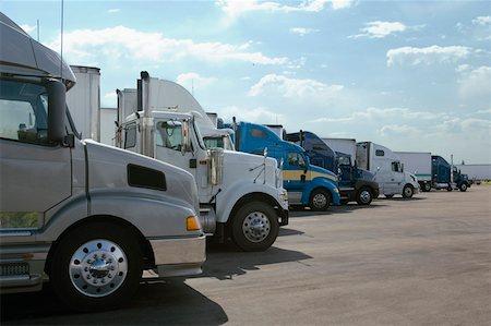 side view tractor trailer truck - Row of semi-trucks Stock Photo - Premium Royalty-Free, Code: 604-01826739