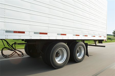 side view tractor trailer truck - Semi-truck trailer on road Stock Photo - Premium Royalty-Free, Code: 604-01826741