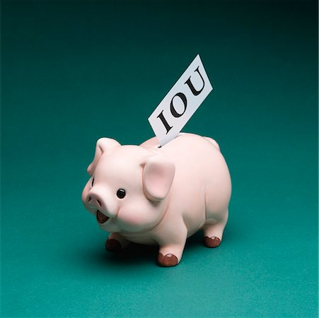 Piggy bank with IOU Stock Photo - Premium Royalty-Free, Code: 604-01826937