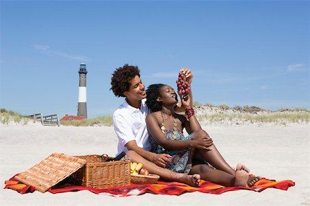 Couple having picnic on beach Stock Photo - Premium Royalty-Free, Code: 604-02043693