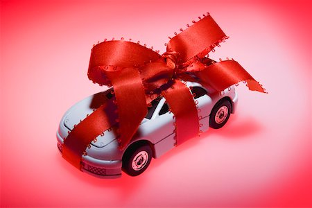 Toy car wrapped in ribbon Stock Photo - Premium Royalty-Free, Code: 604-02043841