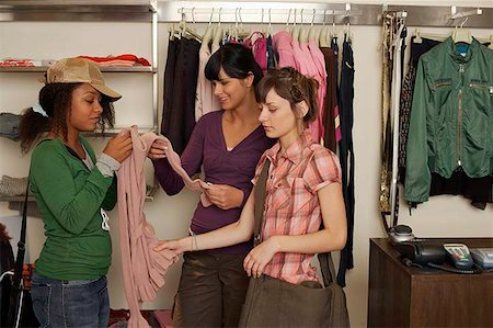 Teenage girls shopping for clothes Stock Photo - Premium Royalty-Free, Code: 604-02288684