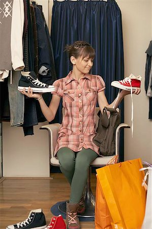 Teenage girl shoe shopping Stock Photo - Premium Royalty-Free, Code: 604-02288685