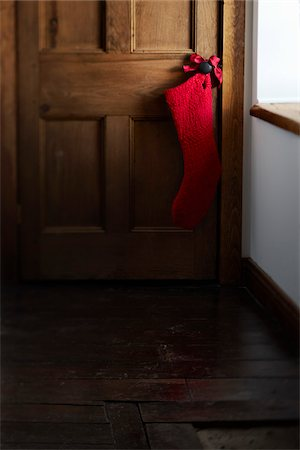 Christmas Stocking Hanging on Doorknob Stock Photo - Premium Royalty-Free, Code: 600-04183477