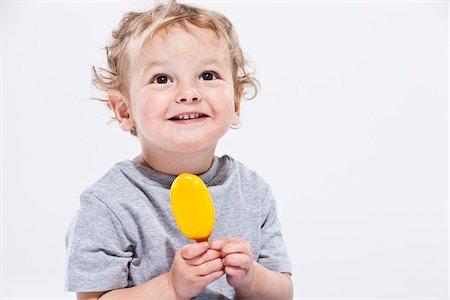 Portrait of Boy Holding Ice Cream Treat Stock Photo - Premium Royalty-Free, Code: 600-04183472