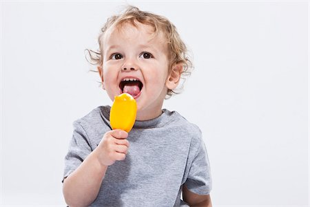 Portrait of Boy Eating Ice Cream Treat Stock Photo - Premium Royalty-Free, Code: 600-04183473