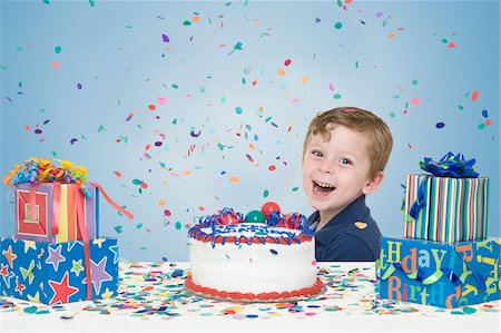 Young Boy with Birthday Cake and Presents Stock Photo - Premium Royalty-Free, Code: 600-04223478