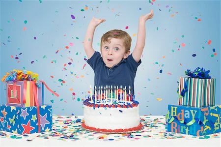 Young Boy with Birthday Cake and Presents Stock Photo - Premium Royalty-Free, Code: 600-04223479