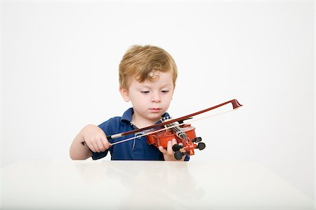 Young Boy Playing Violin Stock Photo - Premium Royalty-Free, Code: 600-04223487