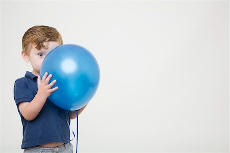 shy baby - Young Boy Playing with Balloon Stock Photo - Premium Royalty-Free, Code: 600-04223488