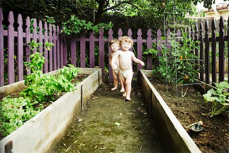 Twin Boys Playing in Garden Stock Photo - Premium Royalty-Free, Code: 600-04223489