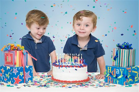 family image and confetti - Twin Boys with Birthday Cake and Presents Stock Photo - Premium Royalty-Free, Code: 600-04223480