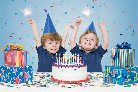 family image and confetti - Twin Boys holding Sparklers with Birthday Cake and Presents Stock Photo - Premium Royalty-Free, Code: 600-04223482