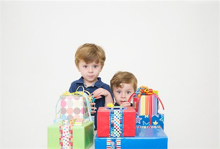 Twin Boys with Birthday Presents Stock Photo - Premium Royalty-Free, Code: 600-04223483