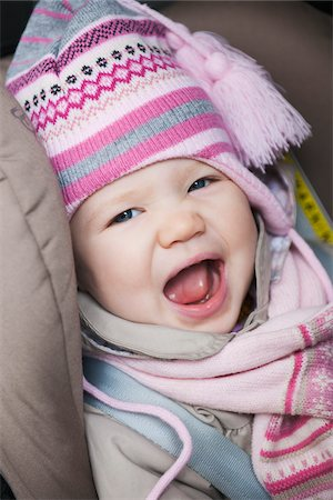 Close-up of Baby Girl Sitting in Car Seat wearing Winter Clothing Stock Photo - Premium Royalty-Free, Code: 600-04425024