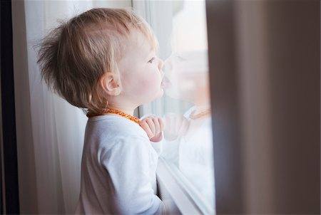Portrait of Baby Girl Looking out Window Stock Photo - Premium Royalty-Free, Code: 600-04425026