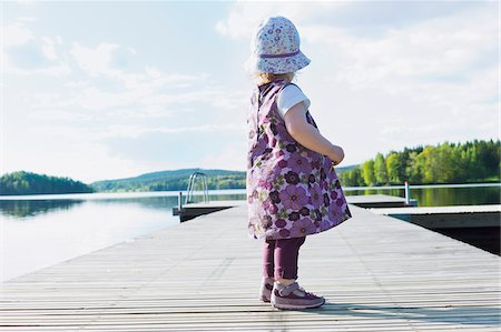 Girl Standing on Dock Stock Photo - Premium Royalty-Free, Code: 600-04525175