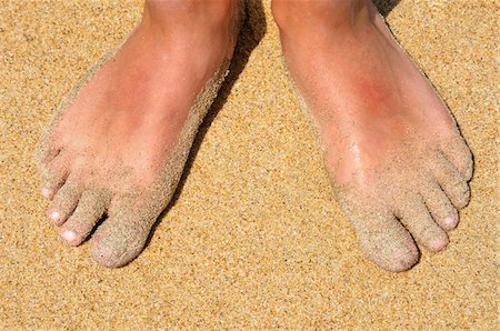 Feet in Sand Stock Photo - Premium Royalty-Free, Code: 600-04625263