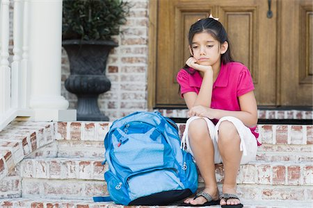 Girl with Backpack Sitting on Steps Stock Photo - Premium Royalty-Free, Code: 600-04625349
