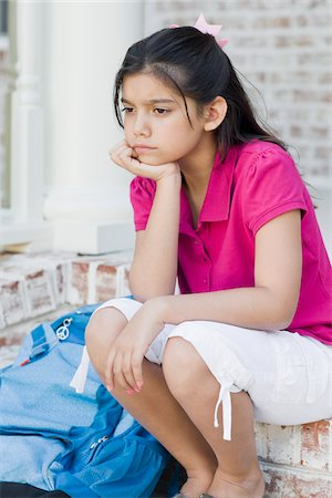 Girl with Backpack Sitting on Steps Stock Photo - Premium Royalty-Free, Code: 600-04625350