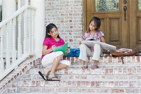 Girls doing Homework on Steps Stock Photo - Premium Royalty-Free, Code: 600-04625353