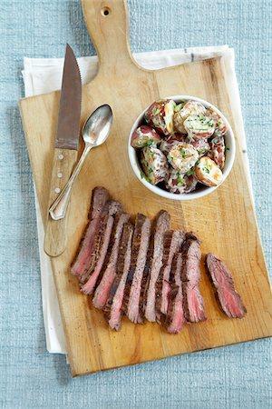 Steak and Potato Salad Stock Photo - Premium Royalty-Free, Code: 600-04625548