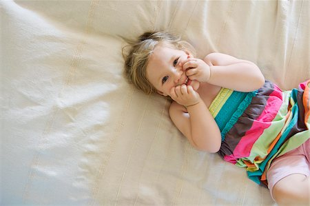 Young Girl Lying in Bed, Sweden Stock Photo - Premium Royalty-Free, Code: 600-04926396